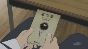 Figure 1: Kasuga holding his favourite book, Charles Baudelaire's Flowers of Evil